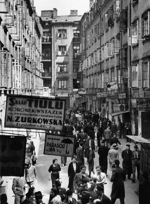 The Nalewki, in the heart of the Jewish quarter of Warsaw, 1938 . For a century the Nalewki had been the commercial center of the Jews of Warsaw. Here they met friends and talked business.