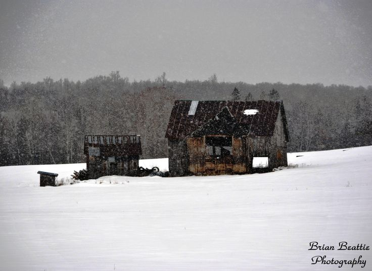 Old barn on a snowy day.