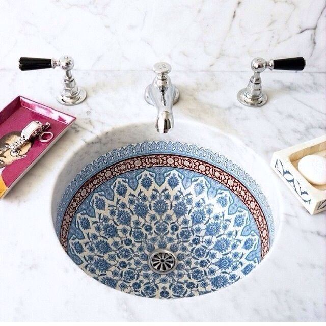 Marrocan style sink to match tile floor in guest bath