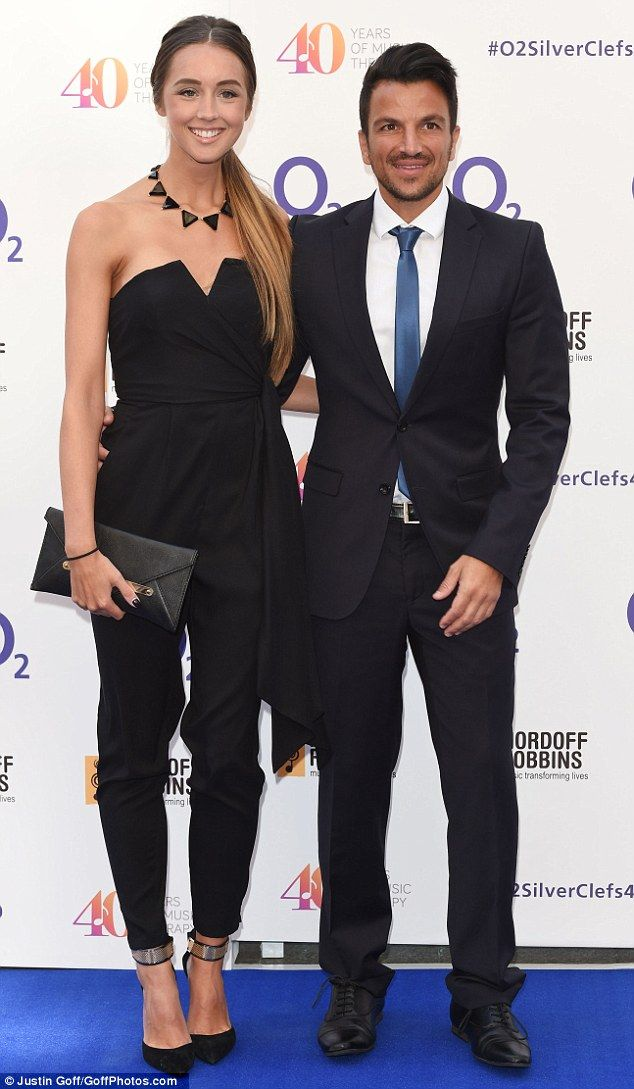 Colour-coordinated couple: The engaged pair looked suitably stylish in their matching black outfits as they posed on the red carpet of the ceremony's 40th anniversary