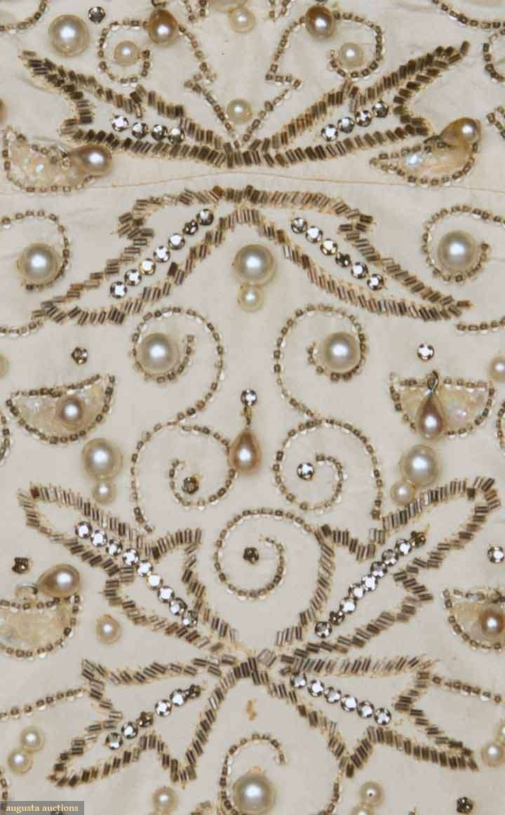 Detail of the embroidery on the jeweled ballgown, 1950s.