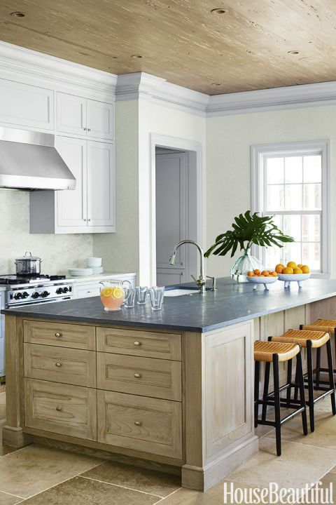 Bring out natural textures with the palest of grays. In a kitchen by Beth Martell, a showstopper island gets its chance to shine thanks to subdued cabinets and trim.