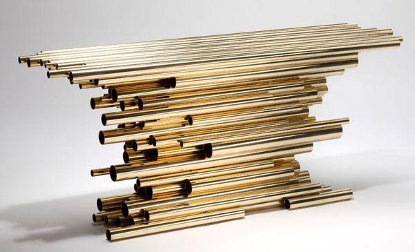 Tube table by Herve Van Der Straten. #exclusivedesign #luxurydesign #exclusivefurniture #goldfurniture #limitededtion #inspirationideias