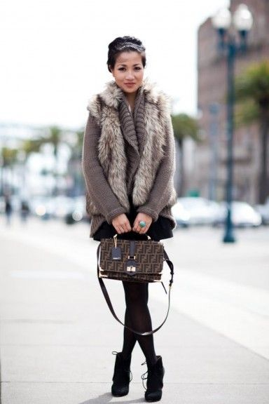 how to wear a fur vest  |  A fur vest over a chunky cardigan or sweater is truly fall layering at it's best.