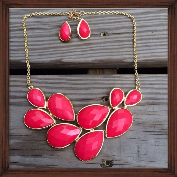 Coral Statement Bib Necklace This color popping, showstopping necklace is a great addition to an ensemble! Coral colored and set in goldtone with an adjustable length. Buy separately or with matching earrings. Jewelry Necklaces