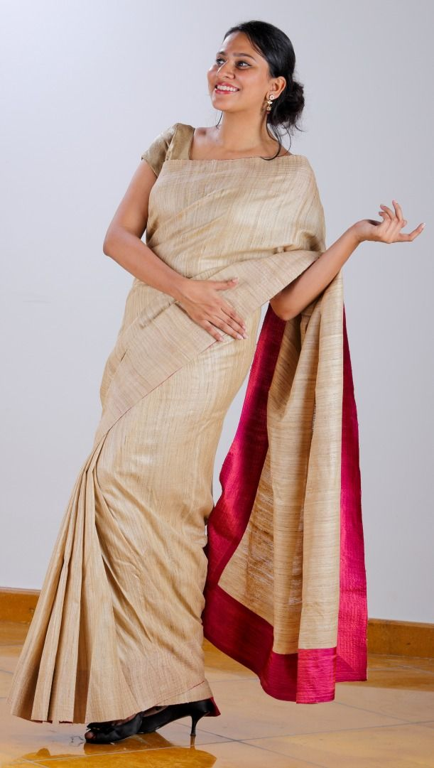 Tussar Silk Saree with bright pink facing teamed with an Ikat inspired geometric screen printed Tussar blouse.  SHOP AT www.ubikaa.com