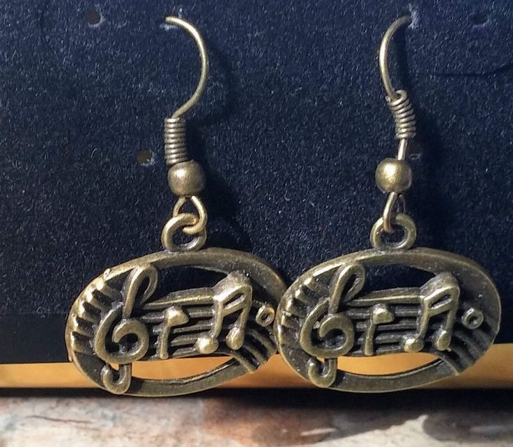 Musical notes drop handmade bronze earrings by SpryHandcrafted on Etsy