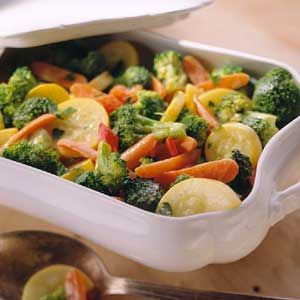 In Italian, primavera (pree-vuh-VEHR-uh) means spring style; with foods, it refers to fresh vegetables. In this low-cal main dish recipe, squash, carrots, red pepper, and broccoli are perfect examples of the Italian definition.