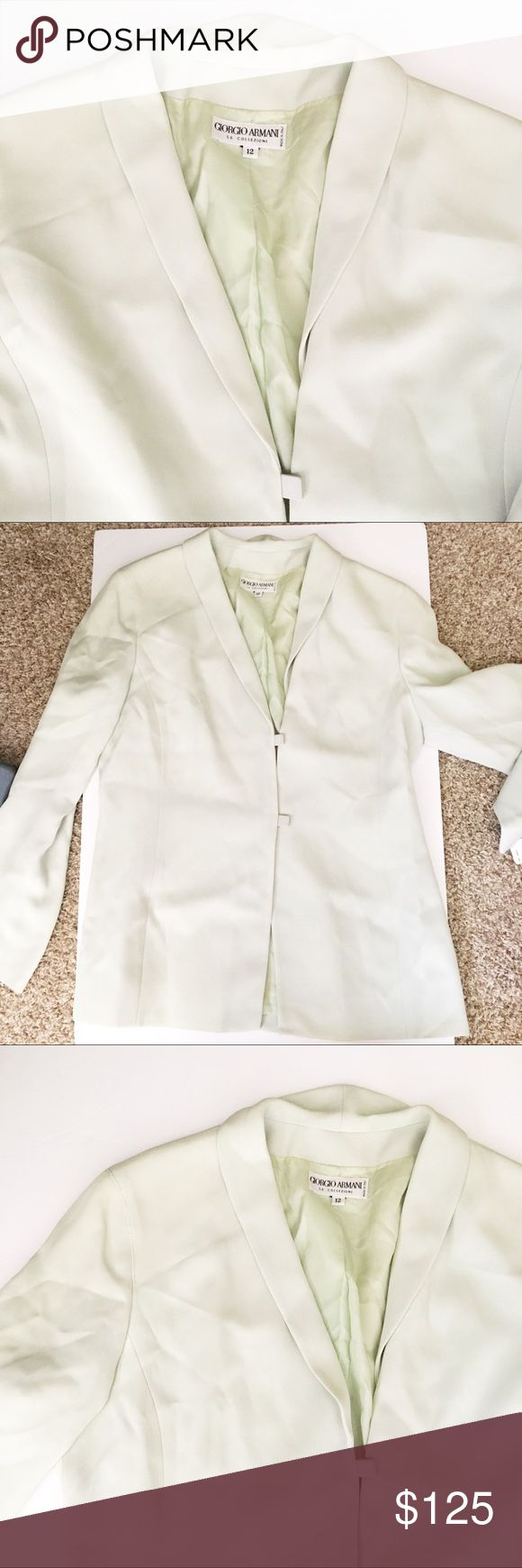 NWT Giorgio Armani Silk Blazer Retails $995. Only flaw is that it's slightly wrinkled but I can't dry clean because the tag is still on. Absolutely stunning. Would make an amazing classy Christmas present! Size 12 (large) fits true to size. Giorgio Armani Jackets & Coats Blazers