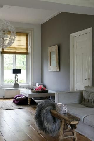 Gorgeous grey lounge with beautiful wide wooden floorboards, mustard roman blind and light grey sofa. I could live here happily.