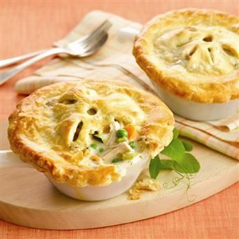 Savory Chicken Pot Pies are the perfect comfort food for guests. Prepare the filling and cut out the pastry ahead to save time in the kitchen. #gourmet #recipes