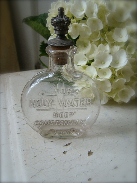 Vintage Holy Water Bottle with Crown    It is believed that basil was found growing on the original cross of Christ when it was discovered by the Empress Helena, and hence it has religious significance in the Greek Orthodox Church, where it is used to sprinkle holy