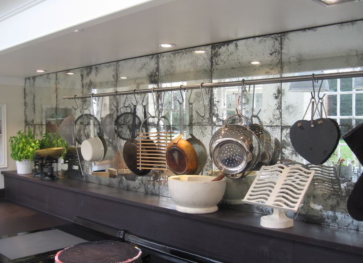 I really like this as an alternative to tiles for the splashback areas of the kitchen. Vintage-feel Mirrored Glass.