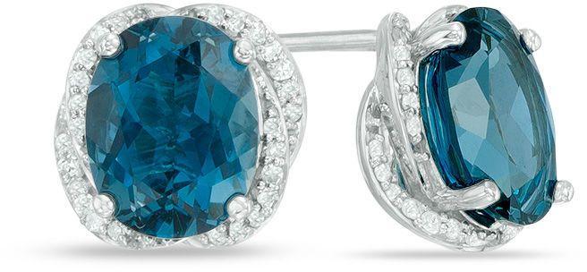 Zales Oval London Blue Topaz and 1/6 CT. T.W. Diamond Swirl Frame Drop Earrings in Sterling Silver