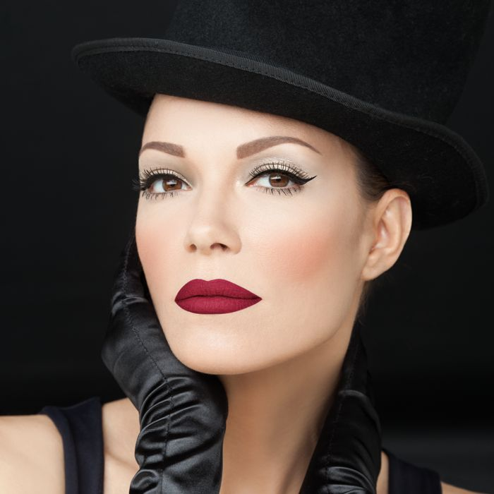 A pair of irresistible red lips combined with black eyeliner will reveal your inner diva! #radiantprofessional #festivelooks #makeup #lips #eyeliner