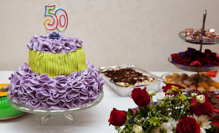 Lilac and green paradise cake. The birthday cake, decorated with delicate lilac ruffles  is filled with a delicious cream.