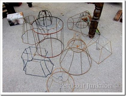 rusty wire lamp shade frames to use for outdoor chandelier.  wire with moss and tilandsia