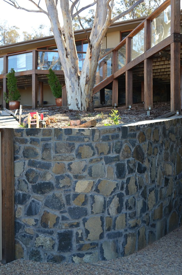 "Rock Flat Basalt using the ""face"" for a retaining wall."