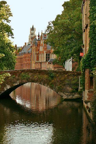 Arched Bridge Over One Of Bruges Canals - Belgium