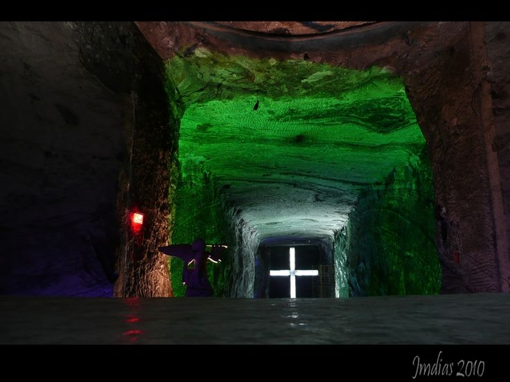 THE WHITE CROSS - Zipaquira, Cundinamarca- Colombia -Here we can see the main part of the Salt Cathedral, there is an angel made of sandstone at right and we can see a huge cross carved in the wall of salt and illuminated inside.