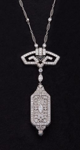 Art Deco Diamond, Onyx & Platinum Pendant Watch & Chain,Beautiful pendant watch and chain, done in intricately pierced geometric designs and bead and bezel-set with 225 single-cut, old European-cut, Transitional-cut, marquise-shaped, rose-cut and round brilliant-cut diamonds. Circa 1920.