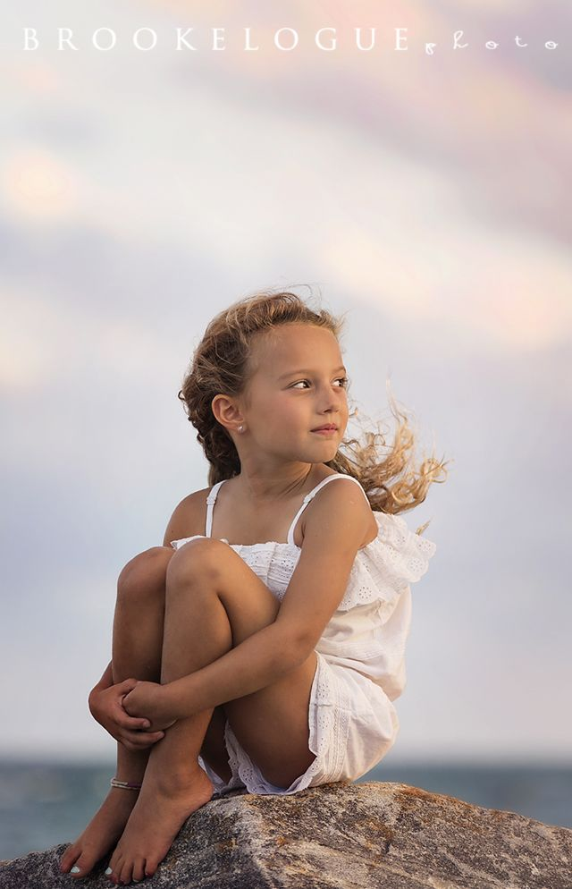 Beautiful child beach portrait during sunset.