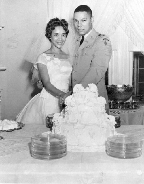 General Colin Powell and his wife Alma - her dress is simply, perfectly elegant. What a great cut!