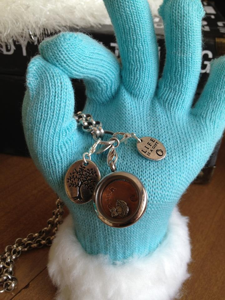 Omg sand in a plastic glove, hidden in a winter glove-jewelry display!!  Origami  Owl custom lockets-