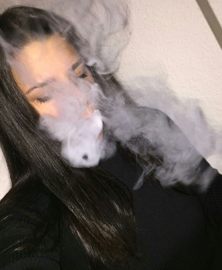 *doesn't see you standing there watching her and she blows out the smoke and closes her eyes*-Abigail