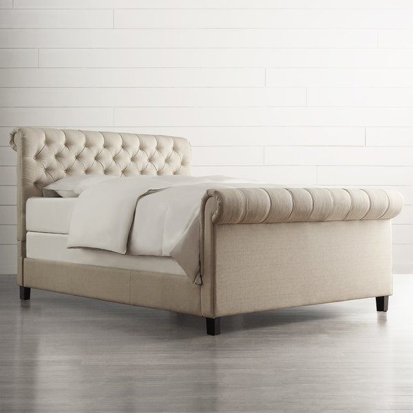 Showcasing diamond-tufted details and a rolled desing, this upholstered bed features a look both timeless and simply elegant. Top it off with a fluffy comforter and satin-trimmed sheets for a hotel feel, or temper its sophisticated design with bright pillows and colorful covers for playful, inviting style.