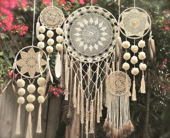 Pic and work by hawkncrow on Etsy.  This is no longer available, but what a great idea right?  Crochet dreamcatchers.  Lovely.