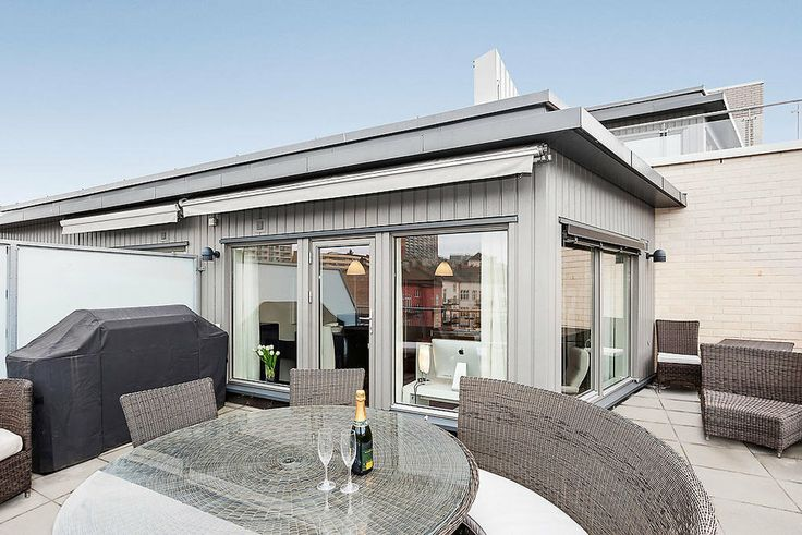 A home in Oslo with an enclosed sunroom. Lovely!