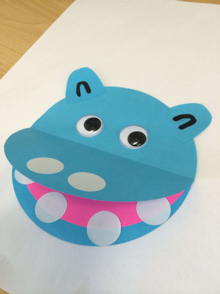 Hippo made by gluing folded blue circle onto full head circle for mouth. Then glue half a pink circle inside to make a tongue. Glue on paper ears, Googly eyes and use stickers for nostrils and teeth