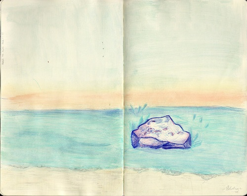 Sitting on beach watching the sun go down. by Kaja Zalokar