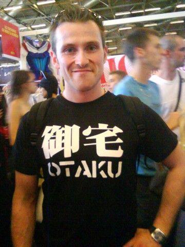 """御宅 (おたく - """"otaku""""): """"your home"""" I think he means """"オタク"""" (geek), but the kanji ruins what he's going for..."""
