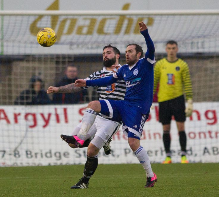 Queen's Park's Bryan Wharton clears the ball during the Ladbrokes League One game between Peterhead and Queen's Park.