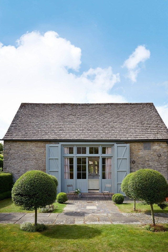 The barn's original doors were rebuilt as shutters and painted in Farrow & Ball's 'Pigeon' gloss