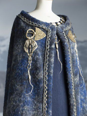 "Woad was also used to dye the wool cloak worn over the dress. Bergin worked, twisted and tied every strand of wool, every bit of decorative animal hair. ""That way we give a life force to the texture. Adding this texture helps create the sense that there are complexities to the character."" And in the disposed Earls' wife's case, these complexities certainly exist."