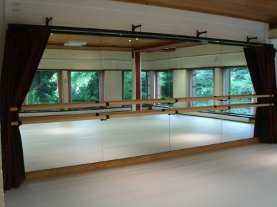 mirror with barre and drapes to close for yoga.