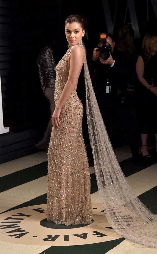 Hailee Steinfeld from 2017 Vanity Fair Oscars After-Party  The actress and singer stunned in a beaded champagne gown with a matching cape flowing behind her.