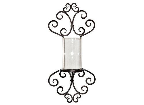 Make any room look perfectly put together with this Shefield wall sconce, which adds plenty of ambience to your space. A clear glass candleholder provides room for your favorite candle, while a chic design in rustic iron offers an attractive transitional feel.