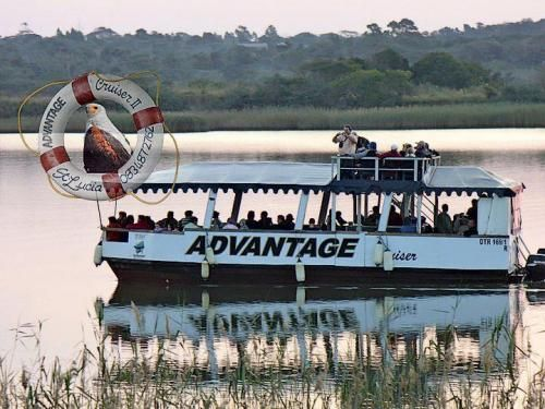 www.bookinsa.com :: click on the photo to view more about this Tour option in SA ::  luxury double deck passenger ferry on Lake St Lucia that specializes in photographic opportunities, taking you up close to hippo's, crocs, and birds & other wildlife