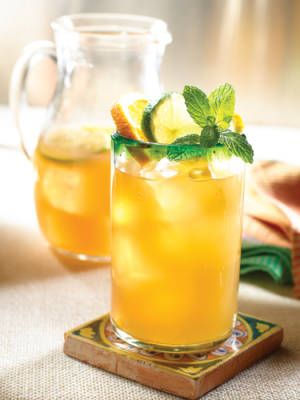 Citrus Tea Punch 2 bottles 100% Natural Lipton Iced Tea with Lemon 1 c. orange juice 1 lemon, sliced 1 lime, sliced 9 oz. tequila Garnish: mint leaves Combine all ingredients in a pitcher. Pour into a glass filled with ice and garnish with mint leaves. Source: Lipton Tea Serves 6 Read more: Tequila Cocktails - Recipes for Tequila Drinks - Cosmopolitan