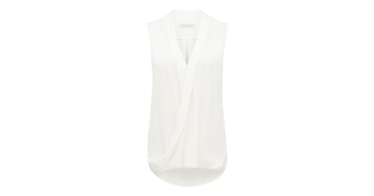 Discover a new wardrobe favourite and channel chic sophistication with our Verity Wrap Front Sleeveless Top, sure to see you transition effortlessly from day to night.