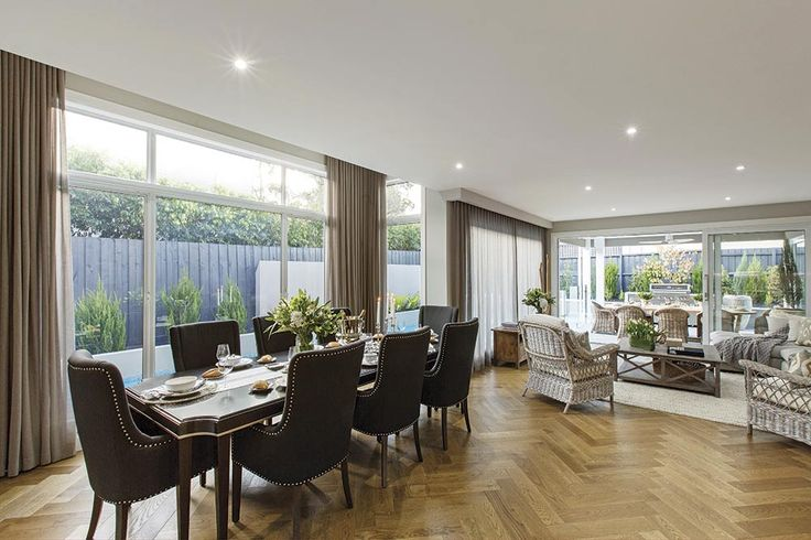 Family dining in the Brookwater Design with Classic Hamptons World of Style.