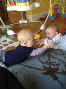 Playdate ideas for Infants - tummy time facing other babies, sing nursery rhymes, play peek a boo, and free play.