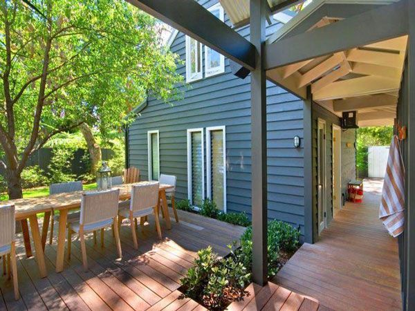 This enclosed courtyard design with a central entertaining deck is the perfect layout for enjoying time outdoors while preserving privacy. The U shape created by the home practically begs...