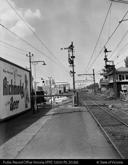 VIEW FROM KENSINGTON UP PLATFORM SHOWING HOME SIGNAL, SIGNAL BOX AND INTERLOCKING GATES - Public Record Office Victoria