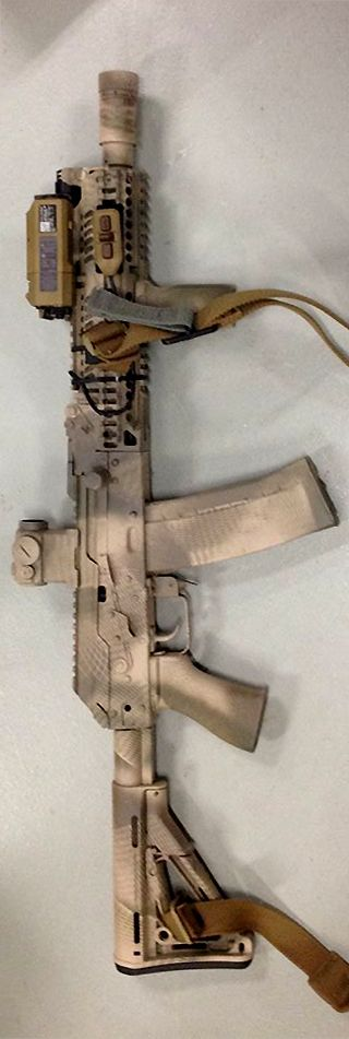 Larry Vickers new AK SBR–Inspired by the AK's he saw Aplha using during his trip to Russia.
