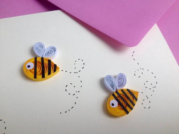 Three busy bees buzzing on a cream coloured card. This is a cute funny card that you can either send or have it mounted and framed to decorate a nursery wall. Quilling is a technique of rolling up thin strips of paper to make different shapes. Every card is made by hand from scratch,